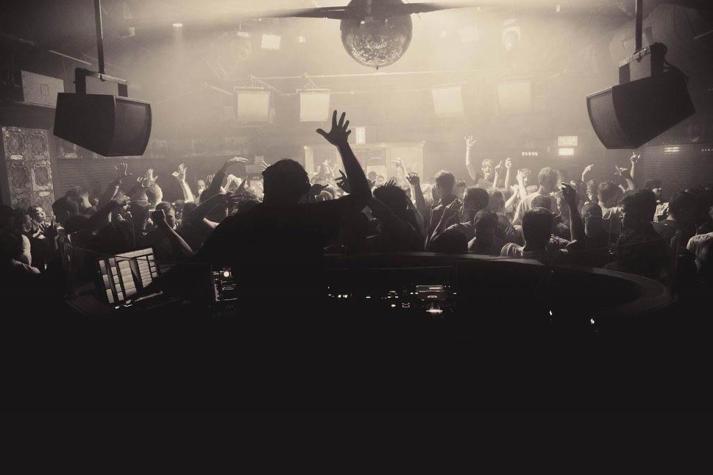 Crowd dancing to a DJ set