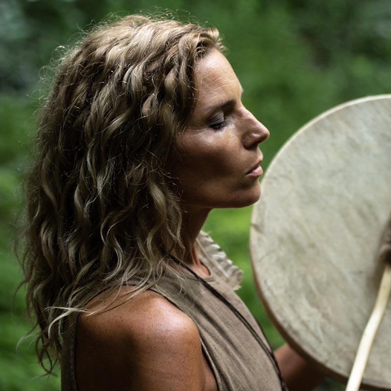 Woman drumming to get back into nature