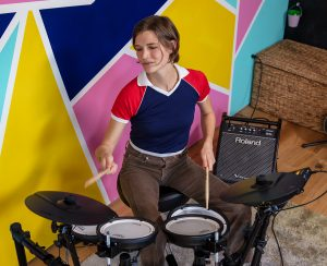 Young drummer playing TD-07